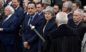 Politicians including the taoiseach, Leo Varadkar, centre left, and the British prime minister, Theresa May, at the funeral of the journalist Lyra McKee.