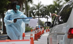 A healthcare worker at a Covid-19 testing site outside of Marlins Park in Miami. Florida reported a record rise in deaths this week.