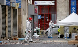 Forensics of the French police are at work outside a building in Saint-Denis, near Paris the day after a police raid to catch fugitives from Friday night's deadly attacks in the French capital