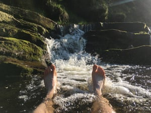 Taking a dip in a Peak District beck.