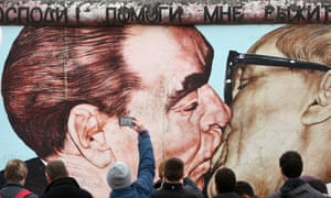 Leonid Brezhnev and Erich Honecker kissing
