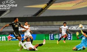 Mason Greenwood shoots the ball at Sevilla's Moroccan goalkeeper Yassine Bounou.