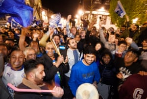 Leicester City supporters celebrate in the streets