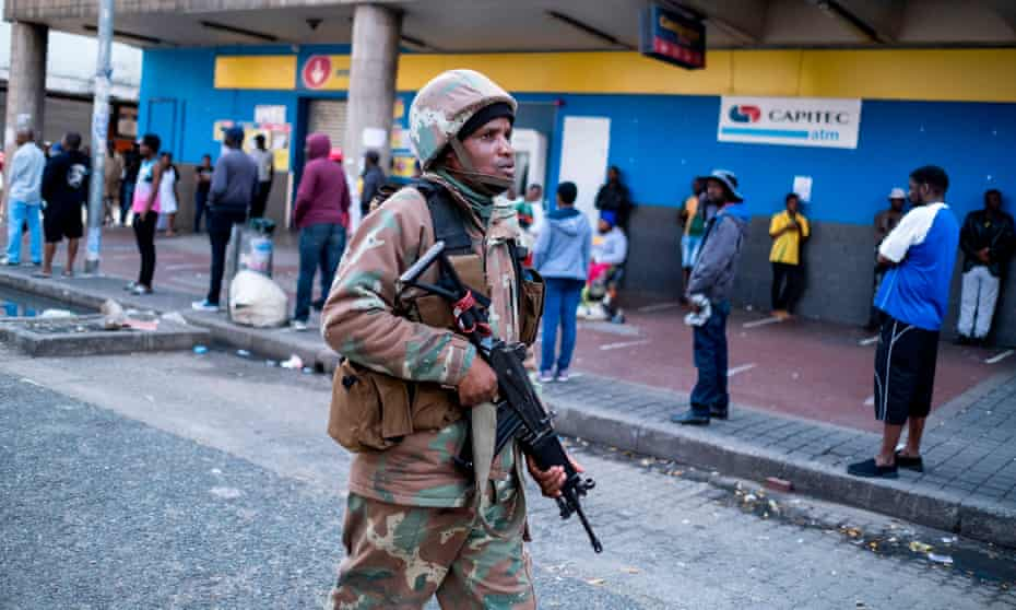 A South African National Defence Force soldier patrols in Hillbrow, Johannesburg