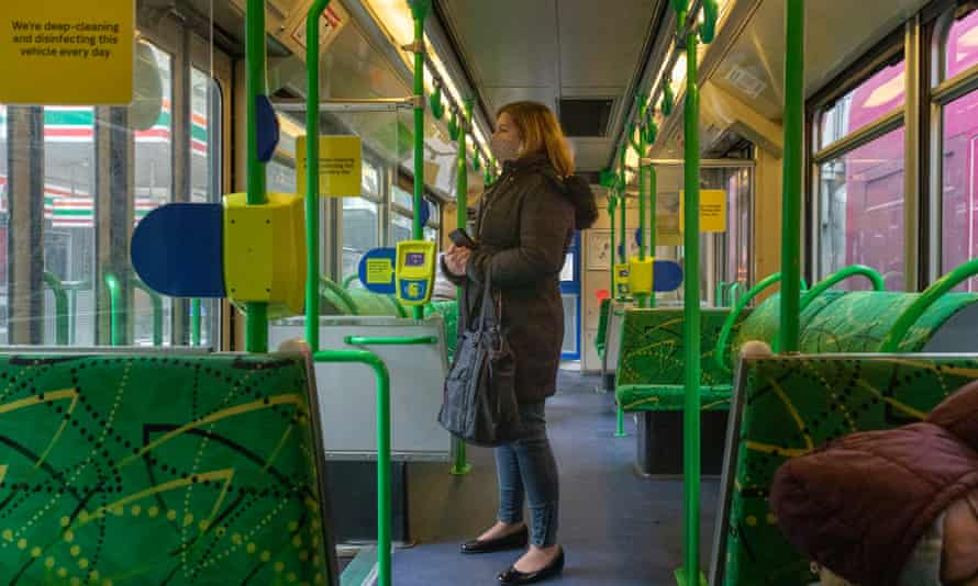 A passenger on a nearly empty Melbourne tram on Friday