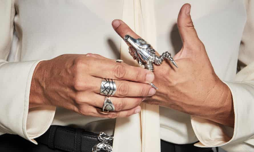 A close-up of Cat Power's hands with chunky silver rings