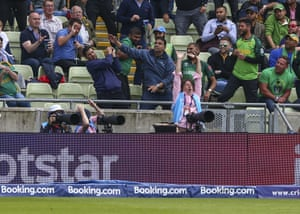 A fan in the crowd catches a 6 hit by Rassie van der Dussen of South Africa.