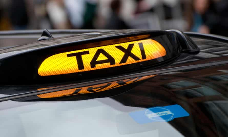 A taxi cab sign in London