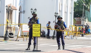 Soldiers stand guard in front of St Anthony's shrine on Monday.