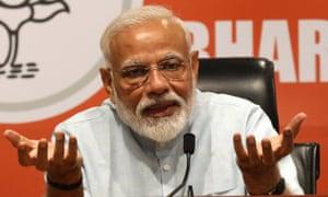 Narendra Modi at a press conference in New Delhi on Friday.
