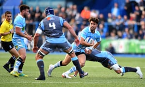 Glasgow's Adam Hastings (centre) is tackled by Olly Robinson of Cardiff Blues during their Champions Cup match.