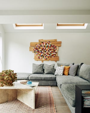 The painting above a bespoke sofa is by owner Cornelia de Ruiter. She found the 1980s geometric travertine coffee table on eBay. The kilim rug is from Dubai; find similar at frenchconnection.com