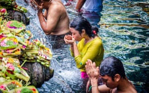 By Adela Voicu. Worshippers pray in waters at Gunung Kawi temple, Bali, Indonesia