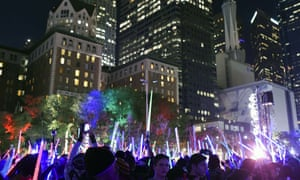 """(FILES) This December 18, 2015 file photo shows Star Wars fans as they raise their lightsabers during Lightsaber Battle LA in Pershing Square in downtown Los Angeles, California. """"Star Wars: The Force Awakens"""" set a record for the highest-grossing opening weekend at the US and Canadian box office with an estimated $238 million in sales, industry monitor Rentrak said December 20, 2015.AFP PHOTO / ROBYN BECK ROBYN BECK/AFP/Getty Images"""