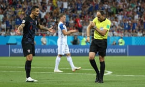 Referee Antonio Mateu Lahoz lets Croatia's Dejan Lovren know why he's given a penalty to Iceland.