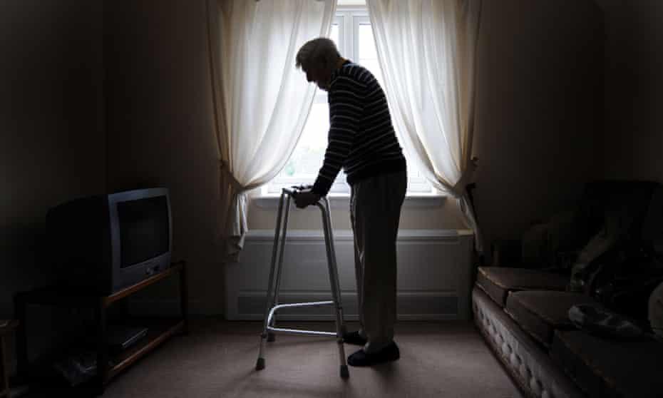 Older man with walking frame at home