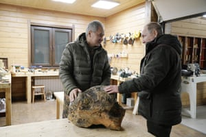 Putin meets Russia's defence minister, Sergei Shoygu, in a wood workshop in a taiga forest.
