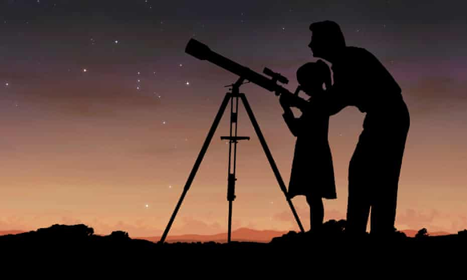 Father and daughter with telescope at night