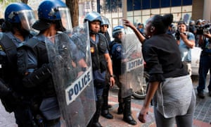 Protesters clash with police during a protest in Cape Town