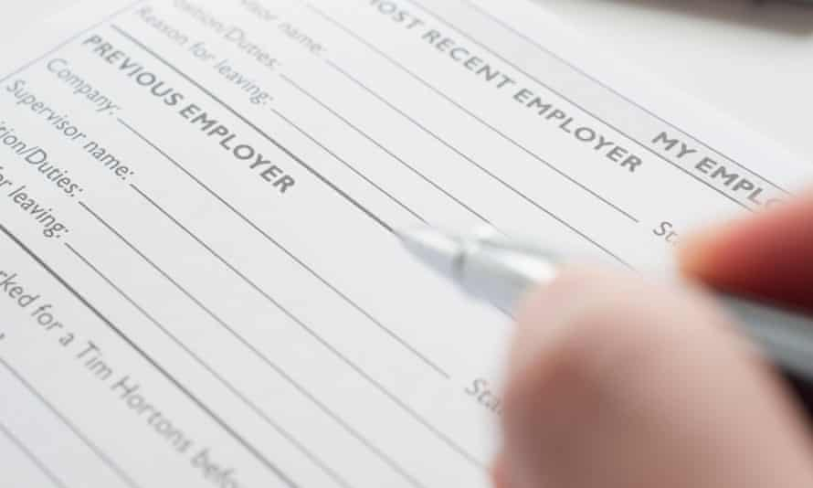 pen poised above job application form
