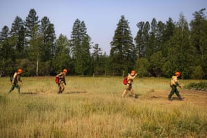 Members of the Aerial Forest Protection Service (AFPS) patrol a 5km-long trench they dug with a tractor some days earlier at the edge of the village of Byas-Kyuel