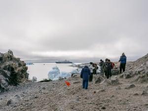 The Ocean Atlantic backgrounds passengers as they explore Paulet Island