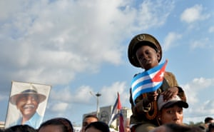 Havana, Cuba A boy holds a Cuban national flag during the May Day rally at Revolution Square