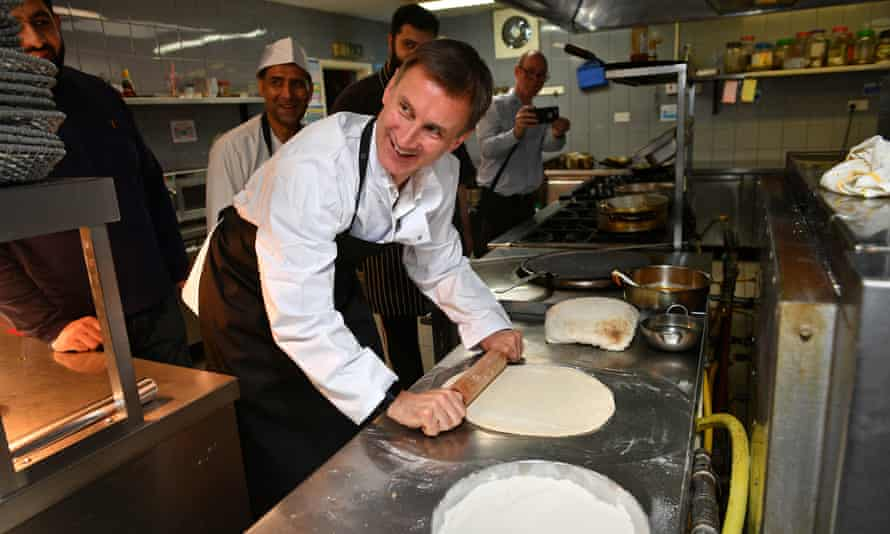 Johnson's rival Jeremy Hunt during a visit to Imran's Balti Restaurant in Birmingham ahead of the hustings.