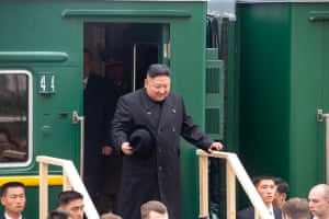 Kim disembarks from a train during for a welcome ceremony at a railway station in the far eastern settlement of Khasan