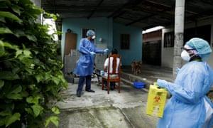 A health ministry worker takes a sample from a resident as his team goes from home to home to administer fast Covid-19 tests in the Nuevo Tocumen neighborhood of Panama City, Monday, 15 June 2020.