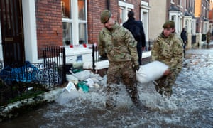 Soldiers help distribute sandbags to residents following flooding in Carlisle on 6 December 2015