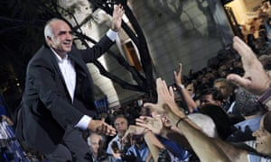 Vangelis Meimarakis, leader of the conservative opposition New Democracy, greets supporters in Athens