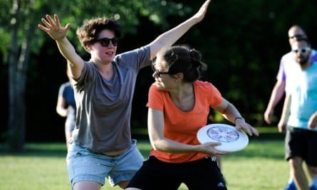 People are seen playing ultimate frisbee in the park in Warsaw, Poland on May 30, 2018.