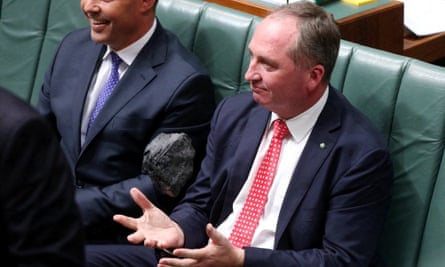 Barnaby Joyce enjoys a piece of coal in parliament.