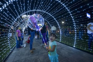 Mejicanos, El Salvador: People gather at a light installation as Christmas celebrations get under way