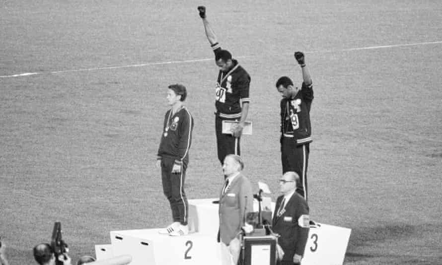 Tommie Smith (centre) and John Carlos make the salute at the 1968 Olympic Games.