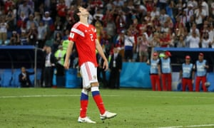 Mario Fernandes of Russia reacts after missing his team's third penalty in the penalty shootout.