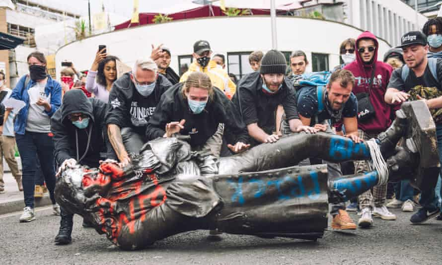Protesters roll the paint-daubed statue of Edward Colston through Bristol on 7 June 2020.
