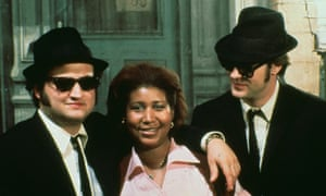 With John Belushi and Dan Ackroyd in The Blues Brothers, in which she performed Think.