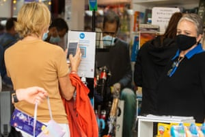 A shopper uses a QR code at the entrance of a store in Manly, Sydney