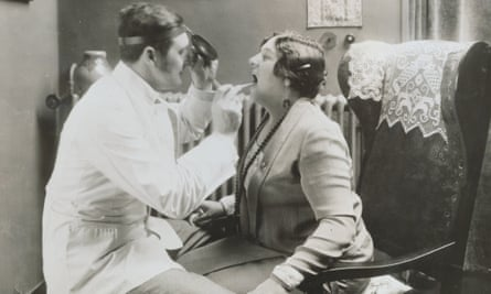 Opera singer Sigrid Onegin (1889–1943) having her vocal cords examined.