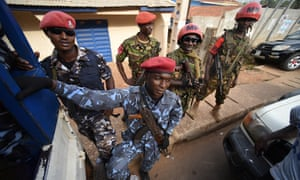 Members of the security forces stand guard during a protest by supporters of the All People's Congress in Freetown