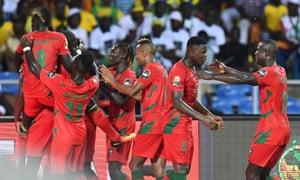 Guinea-Bissau's players celebrate after Soares got a late equaliser.