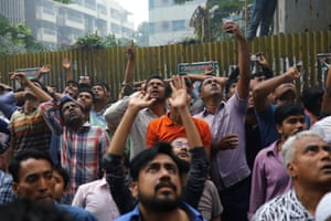 Dhaka, BangladeshPeople react as fire broke out at a multi-storey commercial building in Dhaka