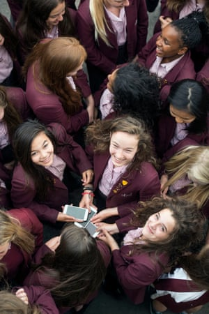 Pupils at Stroud high school with their smartphones.