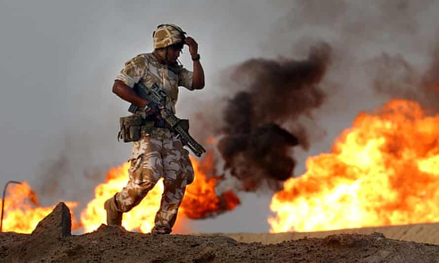 A British soldier during an evening patrol at a gas and oil plant in southern Iraq.