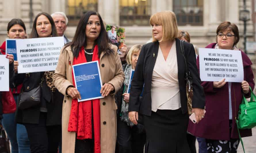 Yasmin Qureshi MP (fourth from left) and chair of the Association for Children Damaged by Hormone Pregnancy Tests, Marie Lyon, (second from right), and families who say they were affected by the drug Primodos arrive for the publication of the report on Hormone Pregnancy Tests.
