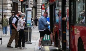 passengers boarding a london bus