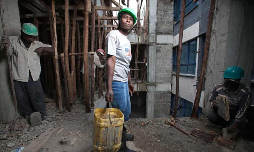 Female construction worker on a high rise building site, Nairobi, Kenya