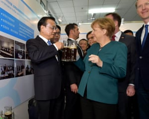 Angela Merkel visit to China - 30 Oct 2015<br>Mandatory Credit: Photo by Xinhua/REX Shutterstock (5331237b) Chinese Premier Li Keqiang (L) and German Chancellor Angela Merkel (C) drink beer brewed by Chinese and German students during their visit to Hefei University in Hefei, capital of east China's Anhui Province Angela Merkel visit to China - 30 Oct 2015